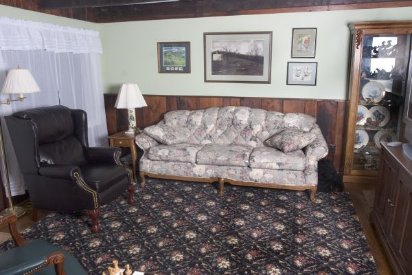 Wood paneling replaced as well as restored hardwood floors and crown moldings.