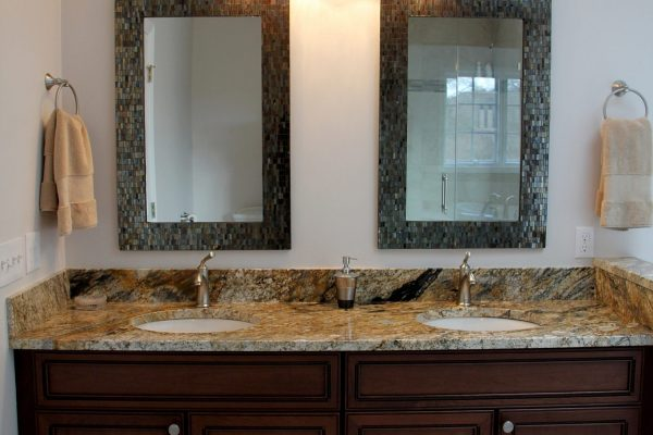 Double vanity with mosaic tiling